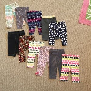 Bundle of 11 stretch pants for baby girl